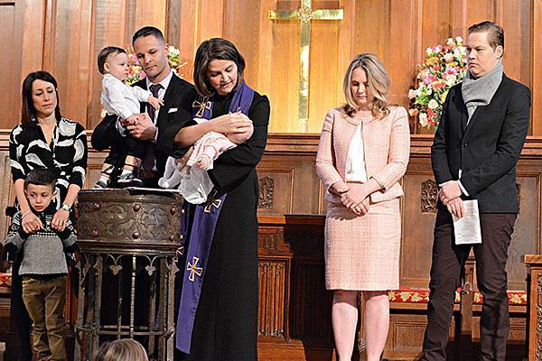 The Rev. Rebecca Kirkpatrick baptizes an infant at Bryn Mawr Presbyterian Church