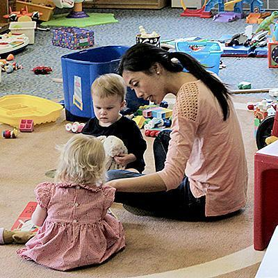 Photo of children in nursery with caregiver